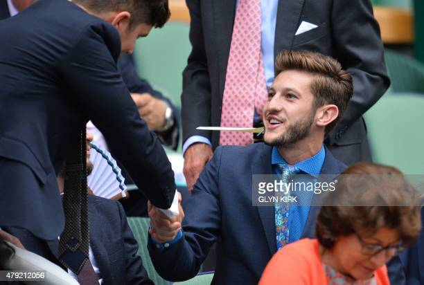Liverpool's English footballer Adam Lallana sits in the Royal Box on Centre Court to watch US player Christina McHale play against Germany's Sabine...