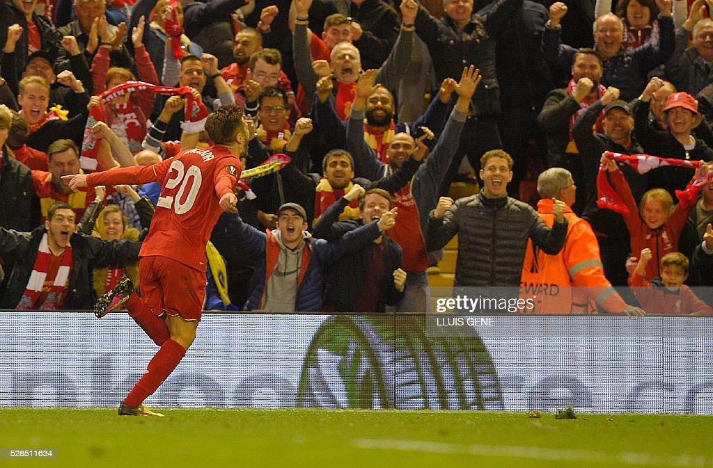 Liverpool's English midfielder Adam Lallana celebrates after scoring his team's third goal during the UEFA Europa League semi-final second leg football match between Liverpool and Villarreal CF at Anfield in Liverpool, northwest England on May 5, 2016. / AFP / LLUIS