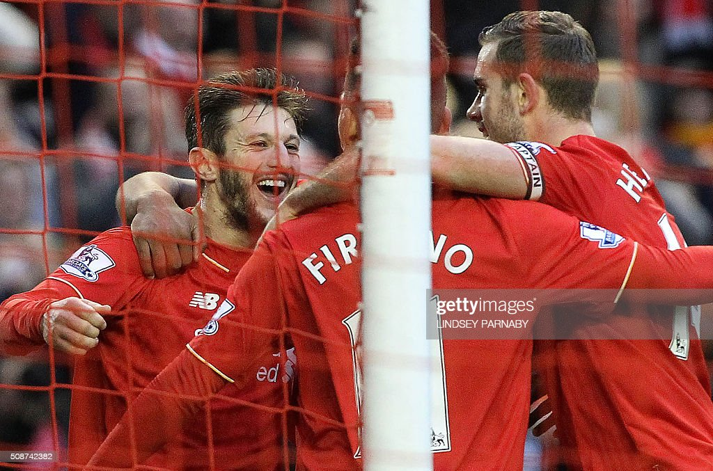 Liverpool's English midfielder Adam Lallana (L) celebrates scoring his team's second goal during the English Premier League football match between Liverpool and Sunderland at Anfield in Liverpool, northwest England, on February 6, 2016. / AFP / LINDSEY PARNABY / RESTRICTED TO EDITORIAL USE. No use with unauthorized audio, video, data, fixture lists, club/league logos or 'live' services. Online in-match use limited to 75 images, no video emulation. No use in betting, games or single club/league/player publications. /