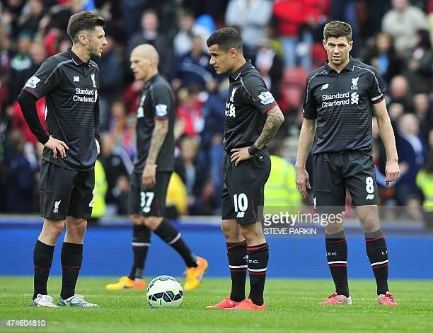 Liverpool's English midfielder Adam Lallana Liverpool's Brazilian midfielder Philippe Coutinho and Liverpool's English midfielder Steven Gerrard wait...
