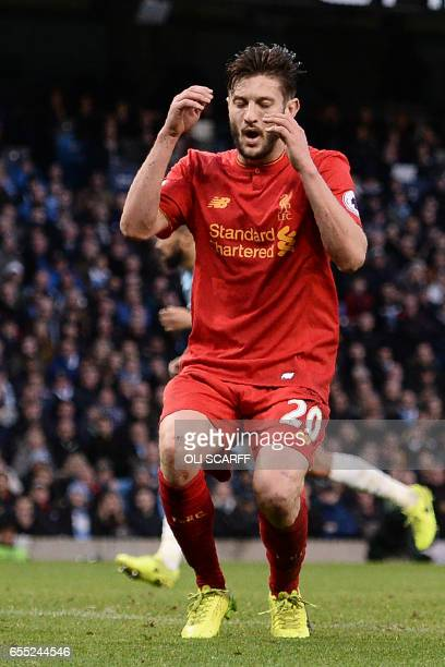 Liverpool's English midfielder Adam Lallana reacts after missing good chance during the English Premier League football match between Manchester City...