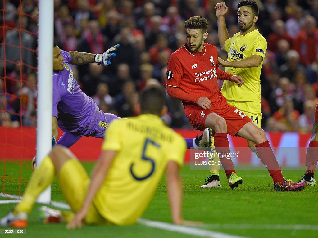 Liverpool's English midfielder Adam Lallana (2nd R) scores his team's third goal during the UEFA Europa League semi-final second leg football match between Liverpool and Villarreal CF at Anfield in Liverpool, northwest England on May 5, 2016. / AFP / LLUIS