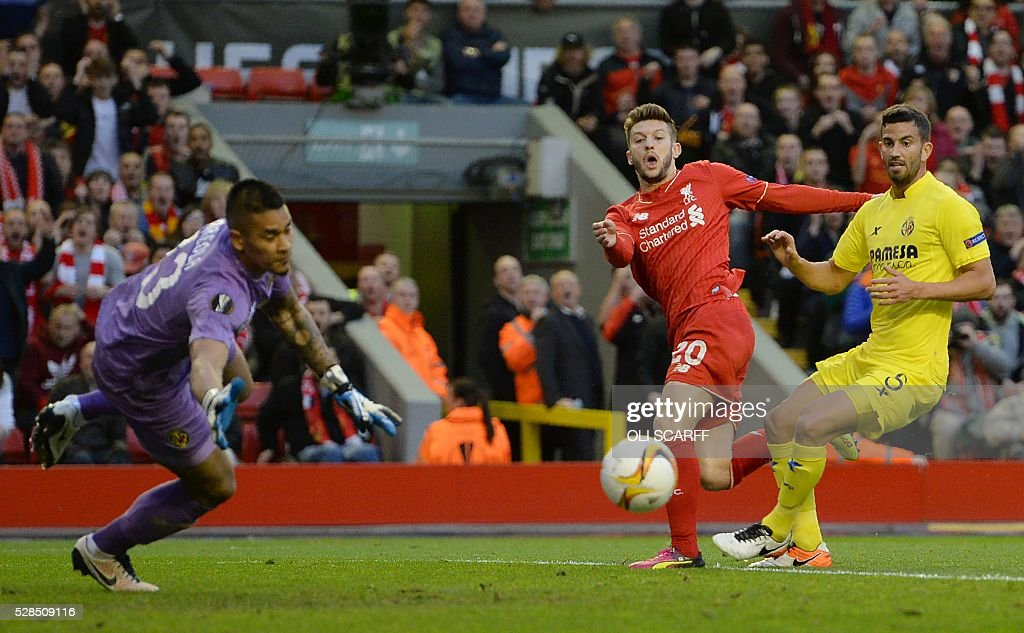 Liverpool's English midfielder Adam Lallana (C) takes an unsuccessful shot at goal during the UEFA Europa League semi-final second leg football match between Liverpool and Villarreal CF at Anfield in Liverpool, northwest England on May 5, 2016. / AFP / OLI