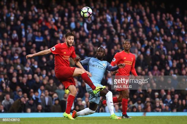 Liverpool's English midfielder Adam Lallana vies with Manchester City's French defender Bacary Sagna during the English Premier League football match...