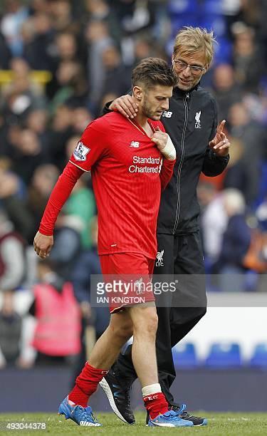 Liverpool's English midfielder Adam Lallana walks off with Liverpool's German manager Jurgen Klopp after the English Premier League football match...