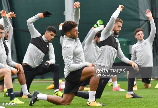 Liverpool's English midfielder Alex OxladeChamberlain annd Liverpool's English midfielder Jordan Henderson attend a team training session at the...