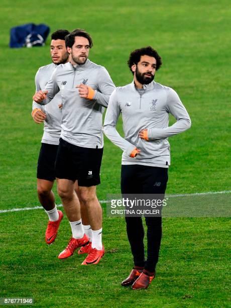 Liverpool's English midfielder Alex OxladeChamberlain Liverpool's English striker Danny Ings and Liverpool's Egyptian midfielder Mohamed Salah run...