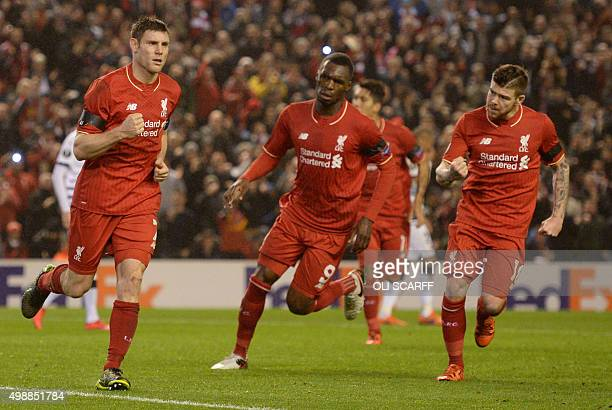 Liverpool's English midfielder James Milner celebrates after scoring from the penalty spot during a UEFA Europa League group B football match between...