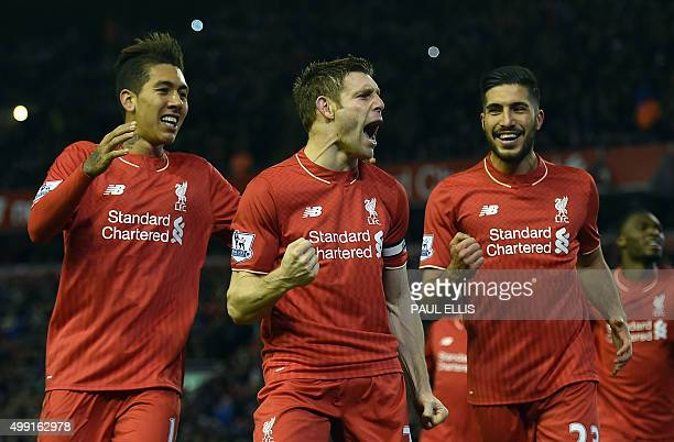 Liverpool's English midfielder James Milner celebrates with Liverpool's Brazilian midfielder Roberto Firmino and Liverpool's German midfielder Emre...