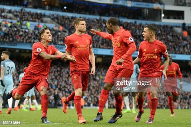 Liverpool's English midfielder James Milner celebrates with teammates after scoring the opening goal from the penalty spot during the English Premier...