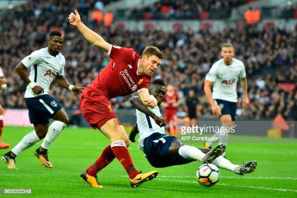 Liverpool's English midfielder James Milner vies with Tottenham Hotspur's Colombian defender Davinson Sanchez during the English Premier League...