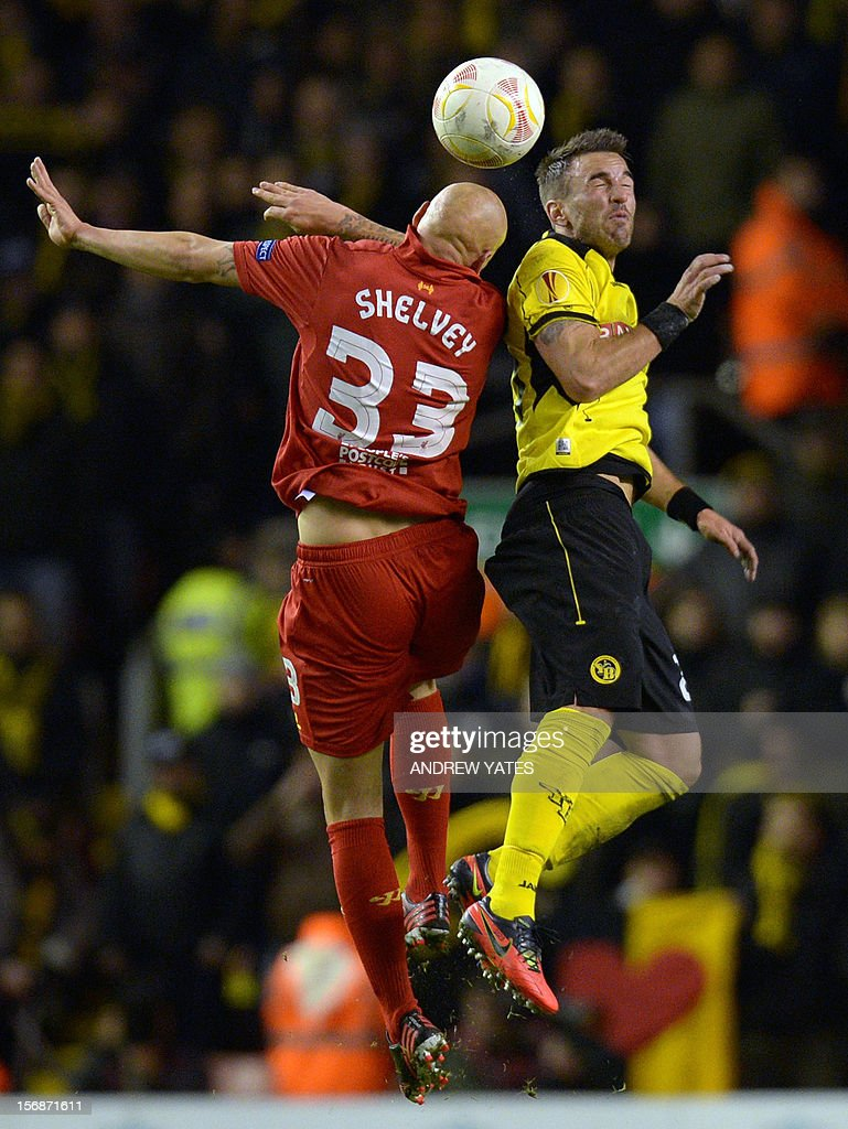 Liverpool's English midfielder Jonjo Shelvey (L) vies with BSC Young Boys Swiss defender Scott Sutter (R) during the UEFA Europa League group A football match between Liverpool and BSC Young Boys at Anfield in Liverpool, north-west England on November 22, 2012.