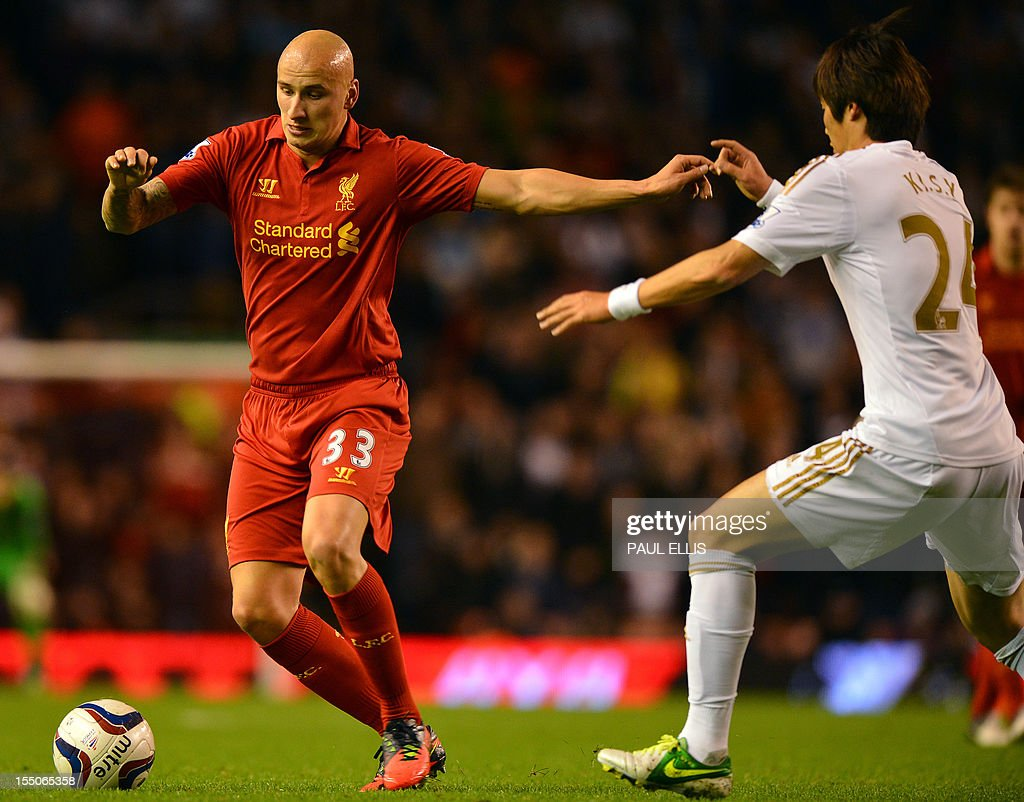 """Liverpool's English midfielder Jonjo Shelvey (L) vies with Swansea City's Korean midfielder Ki Sung-Yueng (R) during the English League Cup Fourth Round football match between Liverpool and Swansea City at Anfield in Liverpool, north-west England on October 31, 2012. USE. No use with unauthorized audio, video, data, fixture lists, club/league logos or """"live"""" services. Online in-match use limited to 45 images, no video emulation. No use in betting, games or single club/league/player publications."""