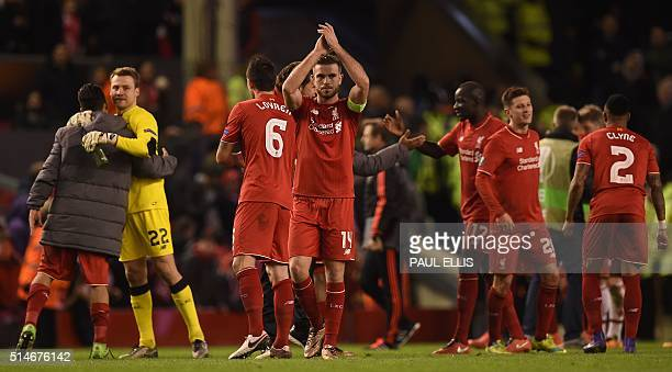 Liverpool's English midfielder Jordan Henderson applauds the fans following the UEFA Europa League round of 16 first leg football match between...