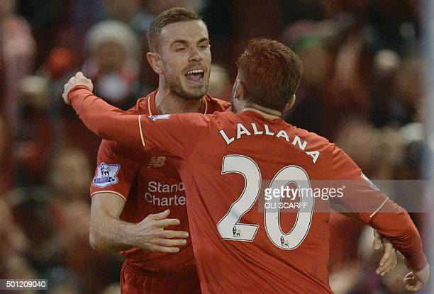 Liverpool's English midfielder Jordan Henderson celebrates with Liverpool's English midfielder Adam Lallana after scoring the opening goal during the...