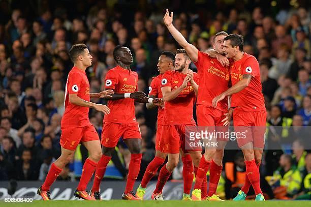 Liverpool's English midfielder Jordan Henderson celebrates with Liverpool's Croatian defender Dejan Lovren after scoring his team's second goal...