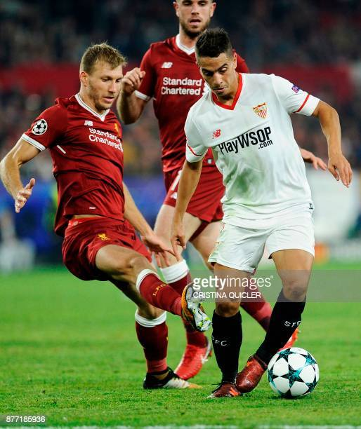 Liverpool's English midfielder Jordan Henderson fights for the ball with Sevilla's French forward Wissam Ben Yedder on November 21 2017 at the Ramon...