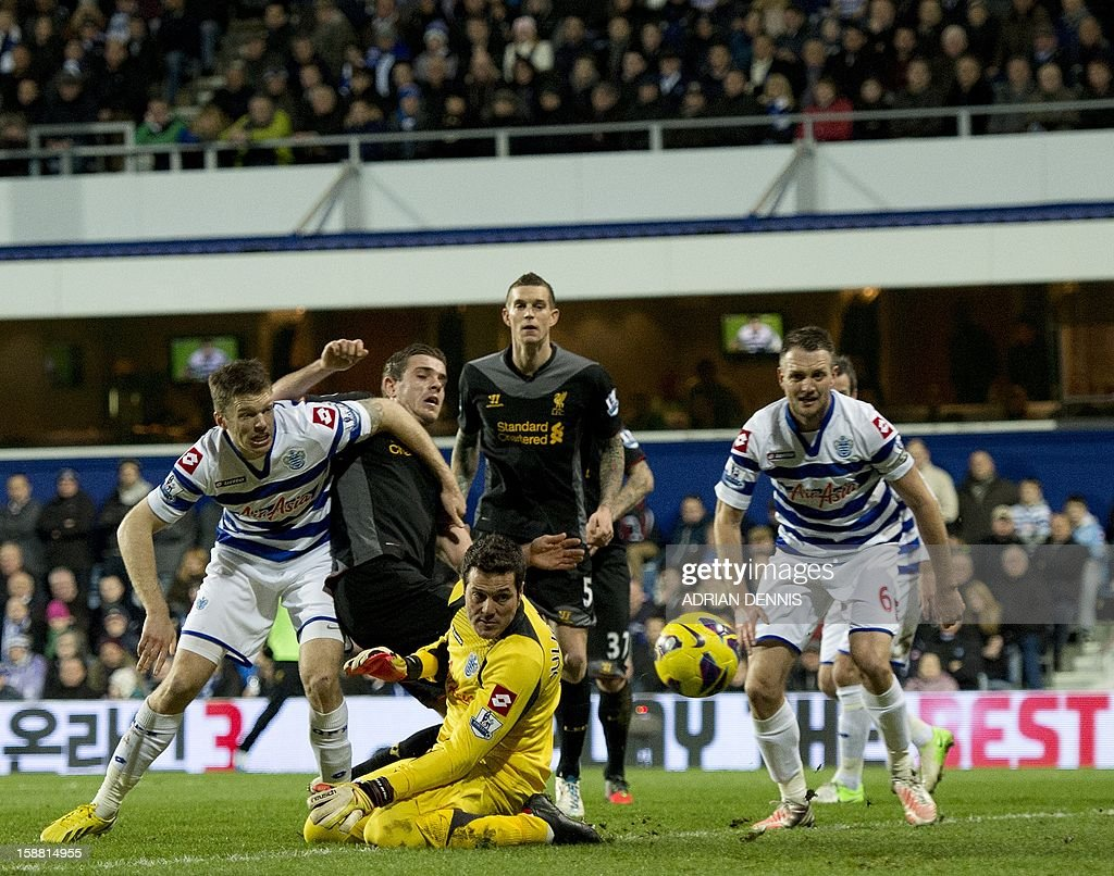 "Liverpool's English midfielder Jordan Henderson (2nd L) gets a shot past Queens Park Rangers' Brazilian goalkeeper Julio Cesar (3rd L) during the Premiership match at Loftus Road in London on December 30, 2012. Liverpool won the game 3-0. USE. No use with unauthorized audio, video, data, fixture lists, club/league logos or ""live"" services. Online in-match use limited to 45 images, no video emulation. No use in betting, games or single club/league/player publications."