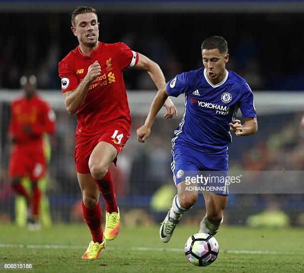 Liverpool's English midfielder Jordan Henderson vies with Chelsea's Belgian midfielder Eden Hazard during the English Premier League football match...