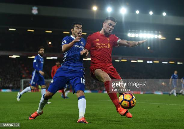 Liverpool's English midfielder Jordan Henderson vies with Chelsea's Spanish midfielder Pedro during the English Premier League football match between...