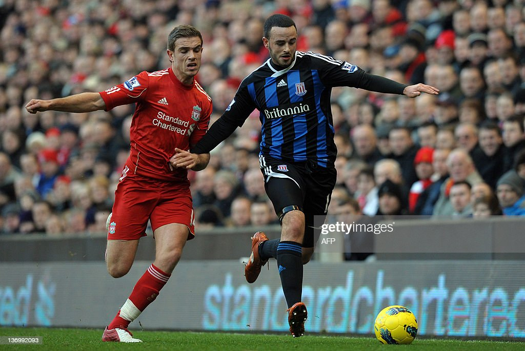 """Liverpool's English midfielder Jordan Henderson (L) vies with Stoke City's Northern Irish midfielder Marc Wilson (R) during the English Premier League football match between Liverpool and Stoke CIty at Anfield in Liverpool, north-west England on January 14, 2012. AFP PHOTO/PAUL ELLIS USE. No use with unauthorized audio, video, data, fixture lists, club/league logos or """"live"""" services. Online in-match use limited to 45 images, no video emulation. No use in betting, games or single club/league/player publications."""