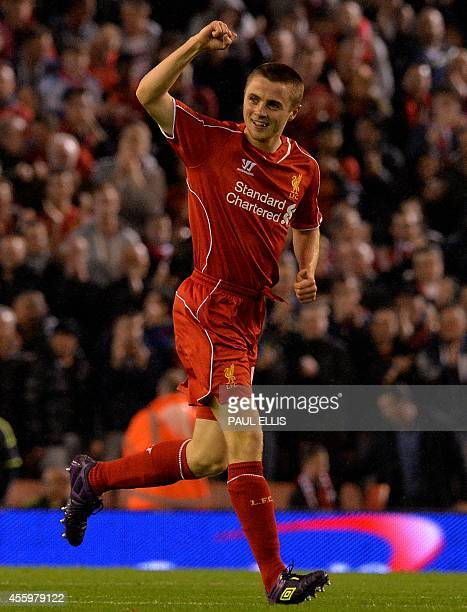 Liverpool's English midfielder Jordan Rossiter celebrates scoring the opening goal of the English League Cup third round football match between...