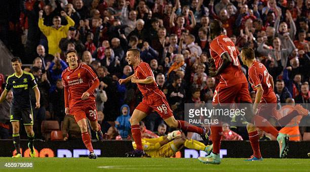 Liverpool's English midfielder Jordan Rossiter celebrates with teammates after scoring the opening goal of the English League Cup third round...