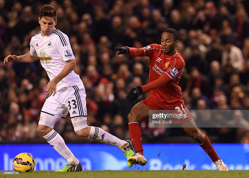 Liverpool's English midfielder <a gi-track='captionPersonalityLinkClicked' href=/galleries/search?phrase=Raheem+Sterling&family=editorial&specificpeople=6489439 ng-click='$event.stopPropagation()'>Raheem Sterling</a> (R) vies with Swansea City's Argentinian defender Federico Fernandez (L) during the English Premier League football match between Liverpool and Swansea City at Anfield in Liverpool, north west England, on December 29, 2014. USE. No use with unauthorized audio, video, data, fixture lists, club/league logos or live services. Online in-match use limited to 45 images, no video emulation. No use in betting, games or single club/league/player publications.