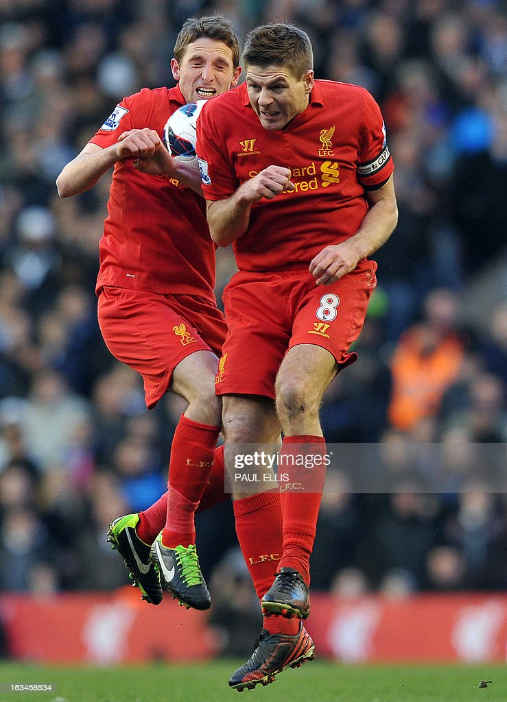 """Liverpool's English midfielder Steven Gerrard (R) and Liverpool's Welsh midfielder Joe Allen head the ball during the English Premier League football match between Liverpool and Tottenham Hotspur at Anfield stadium in Liverpool, northwest England, on March 10, 2013. Liverpool won the match 3-2. USE. No use with unauthorized audio, video, data, fixture lists, club/league logos or """"live"""" services. Online in-match use limited to 45 images, no video emulation. No use in betting, games or single club/league/player publications"""