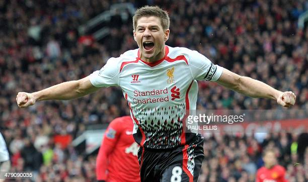 Liverpool's English midfielder Steven Gerrard celebrates after scoring his team's second goal during the English Premier League football match...