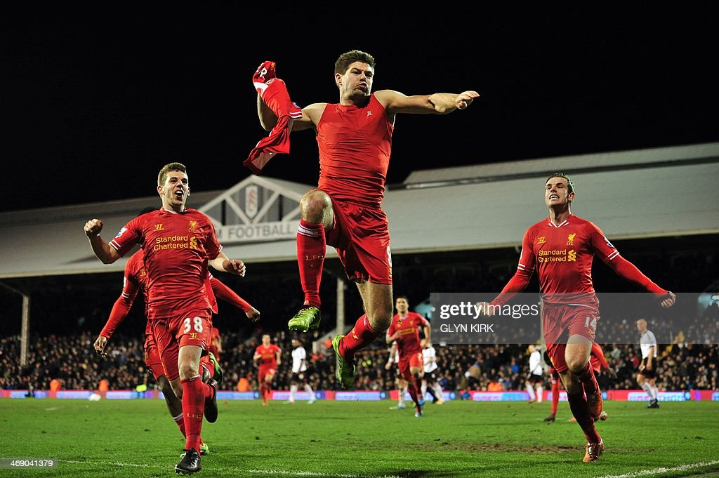 Liverpool's English midfielder <a gi-track='captionPersonalityLinkClicked' href=/galleries/search?phrase=Steven+Gerrard&family=editorial&specificpeople=202052 ng-click='$event.stopPropagation()'>Steven Gerrard</a> (C) celebrates scoring their third goal during the English Premier League football match between Fulham and Liverpool at Craven Cottage in London on February 12, 2014. USE. No use with unauthorized audio, video, data, fixture lists, club/league logos or live services. Online in-match use limited to 45 images, no video emulation. No use in betting, games or single club/league/player publications