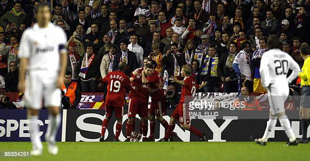 Liverpool's English midfielder Steven Gerrard celebrates with team mates after scoring the second goal during their UEFA Champions League second...