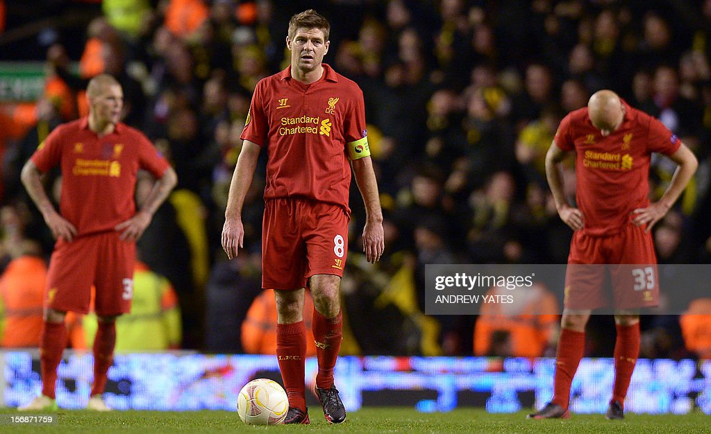 Liverpool's English midfielder Steven Gerrard (C) reacts after Young Boys' second goal leveling the score at 2-2 during the UEFA Europa League group A football match between Liverpool and BSC Young Boys at Anfield in Liverpool, north-west England on November 22, 2012.