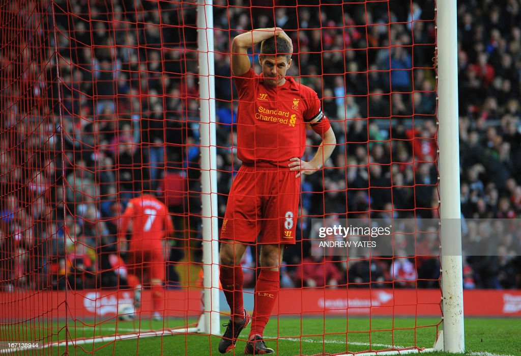 "Liverpool's English midfielder Steven Gerrard reacts during the English Premier League football match between Liverpool and Chelsea at the Anfield stadium in Liverpool, northwest England, on April 21, 2013. The game finished 2-2. USE. No use with unauthorized audio, video, data, fixture lists, club/league logos or ""live"" services. Online in-match use limited to 45 images, no video emulation. No use in betting, games or single club/league/player publications."