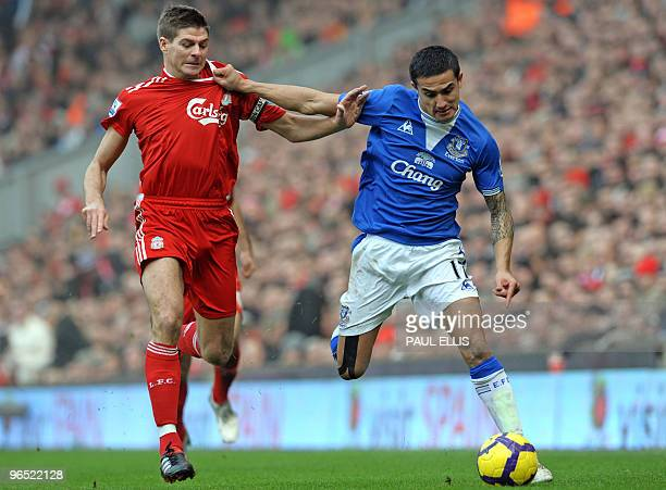 Liverpool's English midfielder Steven Gerrard vies with Everton's Australian midfielder Tim Cahill during the English Premier League football match...