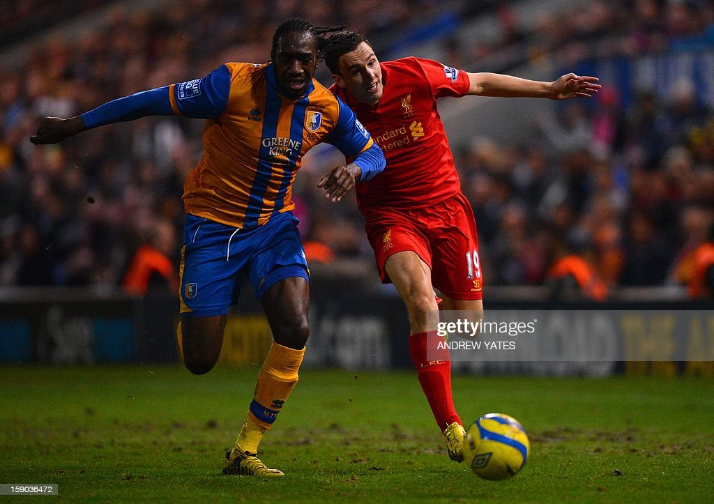 "Liverpool's English midfielder Stewart Downing (R) vies with Mansfield Town's English defender Exodus Geohaghon during the FA Cup third round football match between Mansfield Town and Liverpool at Field Mill in Mansfield, central England, on January 6, 2013. Liverpool won the match 2-1. USE. No use with unauthorized audio, video, data, fixture lists, club/league logos or ""live"" services. Online in-match use limited to 45 images, no video emulation. No use in betting, games or single club/league/player publications."