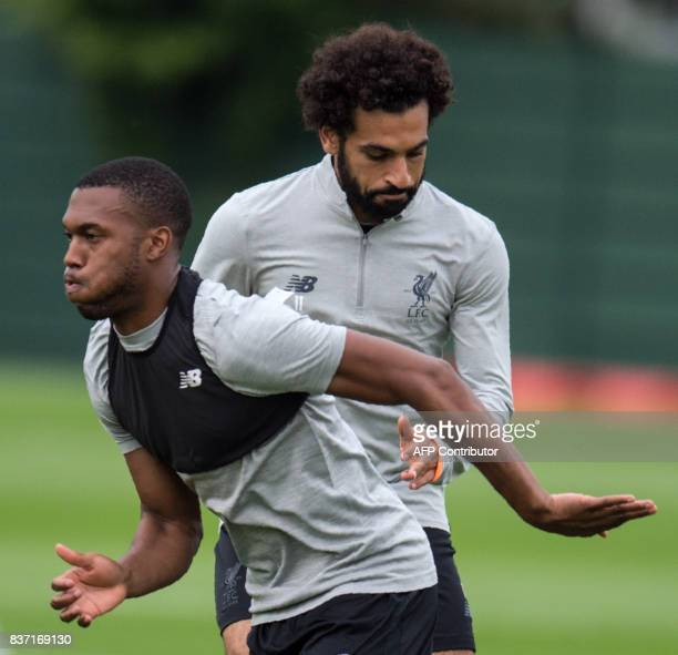 Liverpool's English striker Daniel Sturridge and Liverpool's Egyptian midfielder Mohamed Salah attend a team training session at their Melwood...