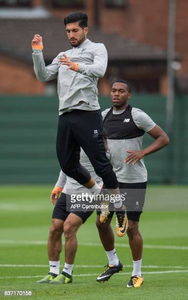 Liverpool's English striker Daniel Sturridge and Liverpool's German midfielder Emre Can take part in a team training session at their Melwood...