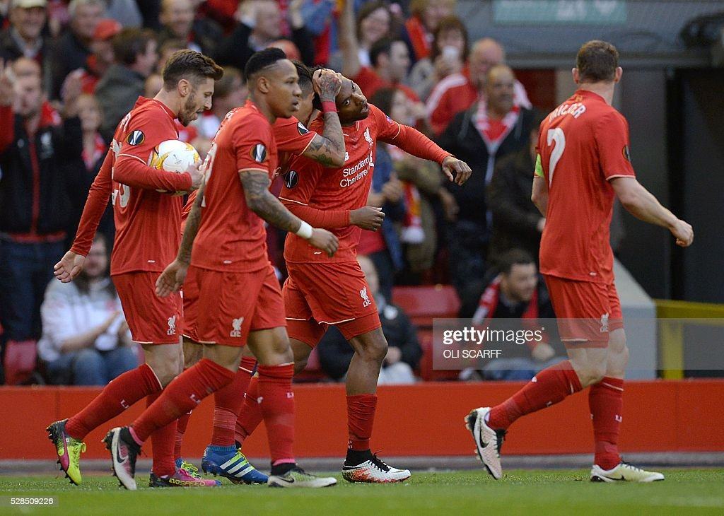 Liverpool's English striker Daniel Sturridge (2nd R) celebrates after an own goal from Villarreal's midfielder Bruno Soriano during the UEFA Europa League semi-final second leg football match between Liverpool and Villarreal CF at Anfield in Liverpool, northwest England on May 5, 2016. / AFP / OLI