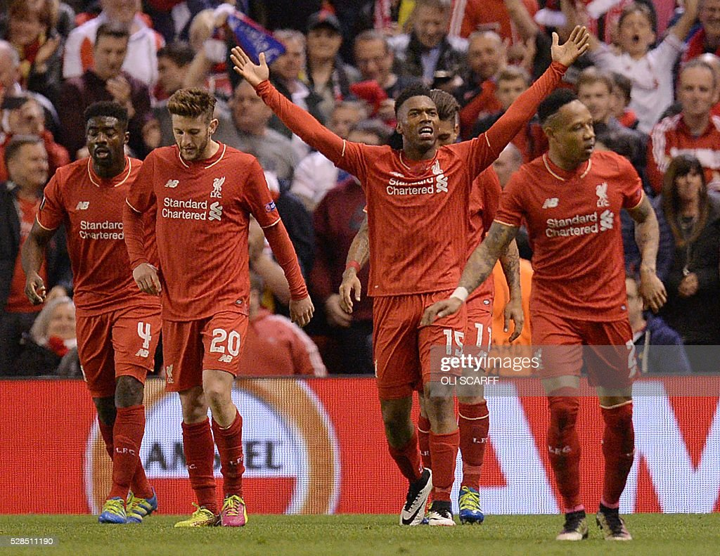 Liverpool's English striker Daniel Sturridge (C) celebrates after scoring his team's second goal during the UEFA Europa League semi-final second leg football match between Liverpool and Villarreal CF at Anfield in Liverpool, northwest England on May 5, 2016. / AFP / OLI
