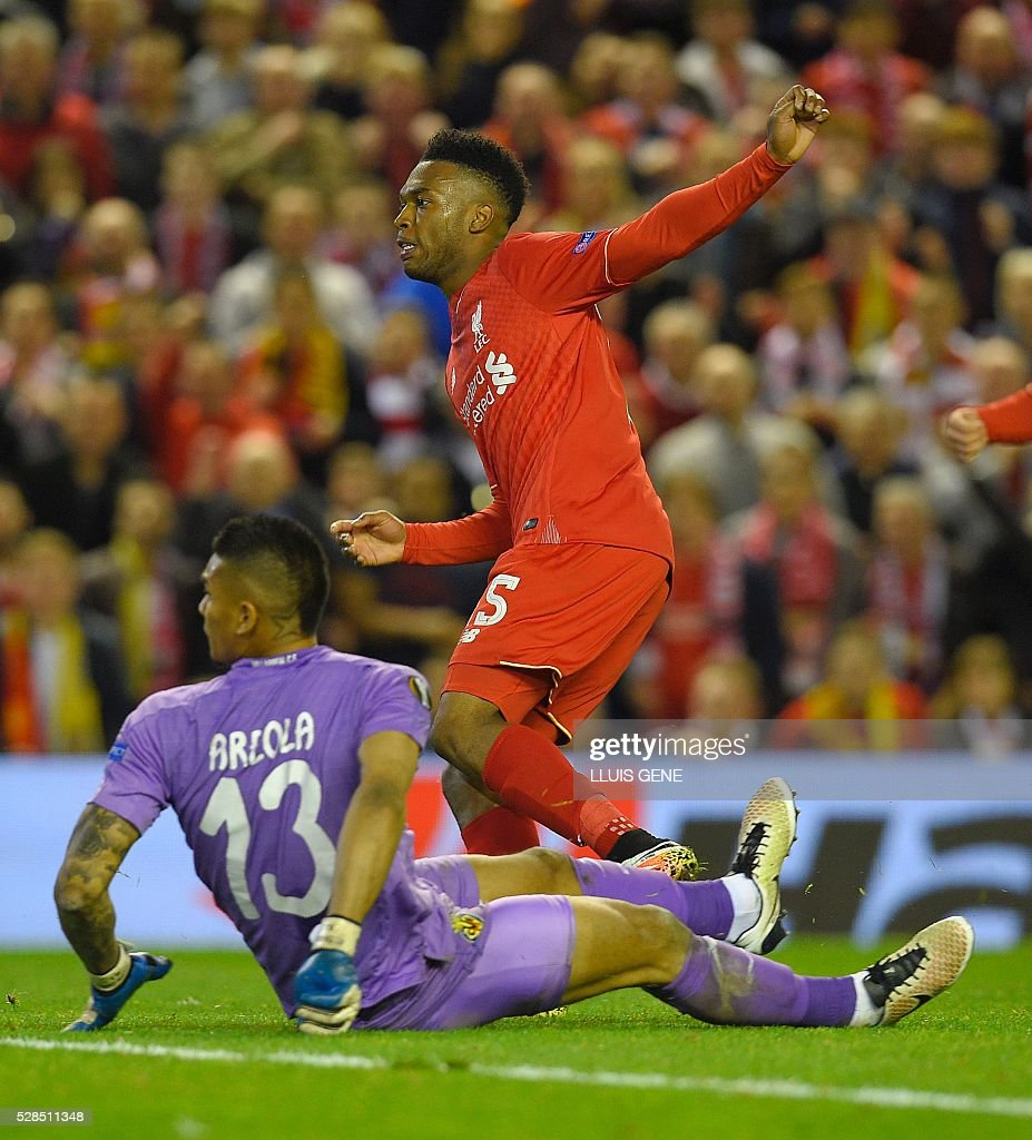 Liverpool's English striker Daniel Sturridge (Top) celebrates after scoring his team's second goal during the UEFA Europa League semi-final second leg football match between Liverpool and Villarreal CF at Anfield in Liverpool, northwest England on May 5, 2016. / AFP / LLUIS