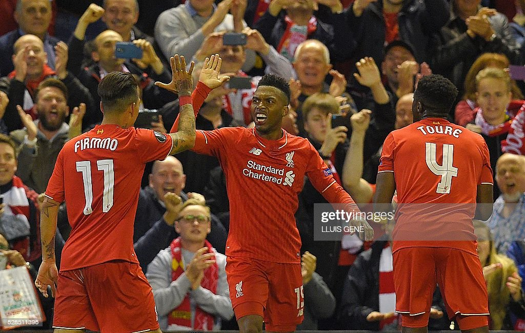 Liverpool's English striker Daniel Sturridge (C) celebrates after scoring his team's second goal during the UEFA Europa League semi-final second leg football match between Liverpool and Villarreal CF at Anfield in Liverpool, northwest England on May 5, 2016. / AFP / LLUIS