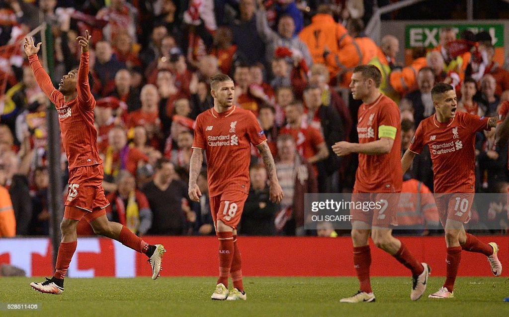 Liverpool's English striker Daniel Sturridge (L) celebrates after scoring his team's second goal during the UEFA Europa League semi-final second leg football match between Liverpool and Villarreal CF at Anfield in Liverpool, northwest England on May 5, 2016. / AFP / OLI