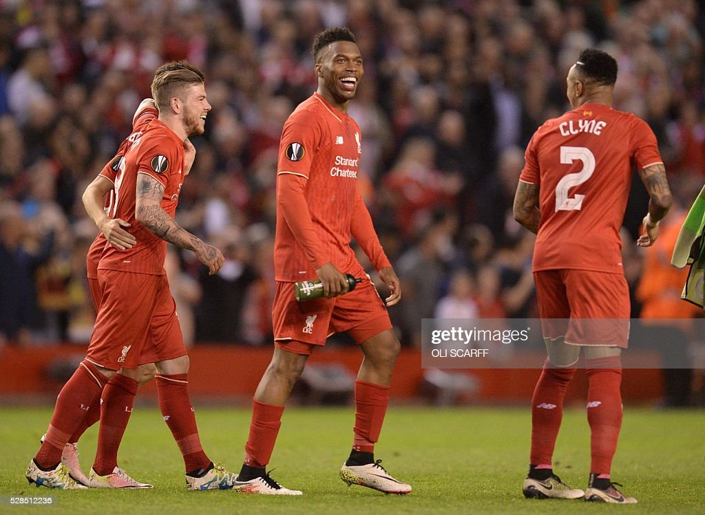 Liverpool's English striker Daniel Sturridge (C) celebrates at the final whistle after a 3-0 victory during the UEFA Europa League semi-final second leg football match between Liverpool and Villarreal CF at Anfield in Liverpool, northwest England on May 5, 2016. / AFP / OLI