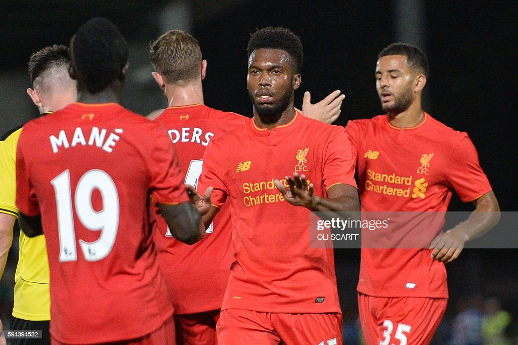 Liverpool's English striker Daniel Sturridge celebrates scoring Liverpool's fifth goal during the English League Cup second round football match...
