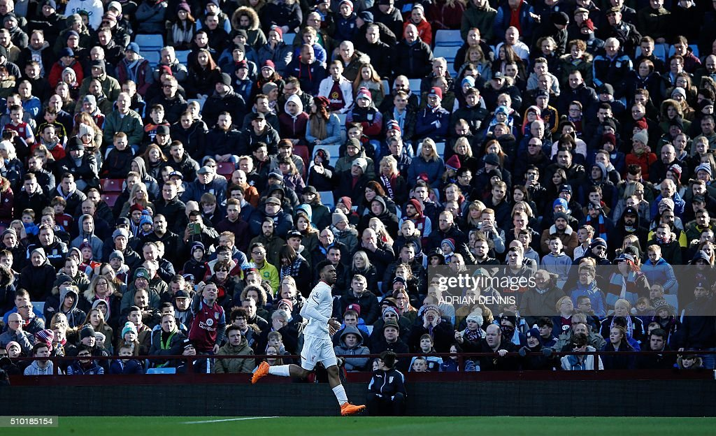 Liverpool's English striker Daniel Sturridge celebrates scoring his team's first goal during the English Premier League football match between Aston Villa and Liverpool at Villa Park in Birmingham, central England on February 14, 2016. / AFP / ADRIAN DENNIS / RESTRICTED TO EDITORIAL USE. No use with unauthorized audio, video, data, fixture lists, club/league logos or 'live' services. Online in-match use limited to 75 images, no video emulation. No use in betting, games or single club/league/player publications. /