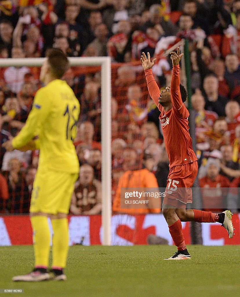 Liverpool's English striker Daniel Sturridge (R) celebrates scoring his team's second goal during the UEFA Europa League semi-final second leg football match between Liverpool and Villarreal CF at Anfield in Liverpool, northwest England on May 5, 2016. / AFP / OLI