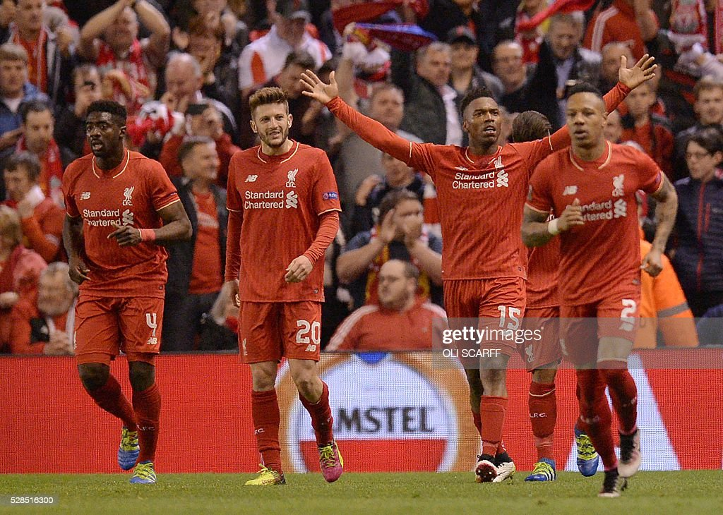 Liverpool's English striker Daniel Sturridge (2nd R) celebrates scoring his team's second goal during the UEFA Europa League semi-final second leg football match between Liverpool and Villarreal CF at Anfield in Liverpool, northwest England on May 5, 2016. / AFP / OLI