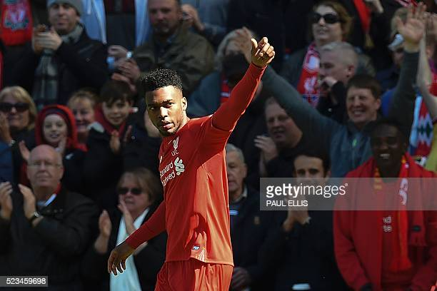 Liverpool's English striker Daniel Sturridge celebrates scoring the opening goal during the English Premier League football match between Liverpool...