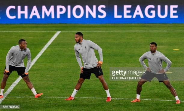 Liverpool's English striker Daniel Sturridge Liverpool's English defender Joe Gomez and Liverpool's Dutch midfielder Georginio Wijnaldum take part in...